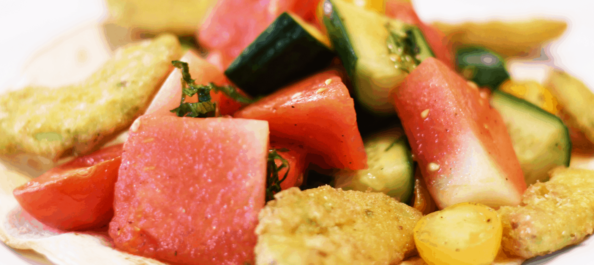 Seasonal fruit and tomato salad with watermelon and cucumber